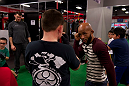 LAS VEGAS, NEVADA - JANUARY 28: UFC flyweight champion Demetrious Johnson demonstrates how to defend a head strike with a young man at the UFC Gym in Green Valley. (Photo by Brandon Magnus/Zuffa LLC/Zuffa LLC)