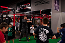 LAS VEGAS, NEVADA - JANUARY 28:  Former UFC light heavyweight champion and UFC hall of famer Forrest Griffin shows a group of children how to throw a punch at the UFC Gym in Green Valley. (Photo by Brandon Magnus/Zuffa LLC/Zuffa LLC)