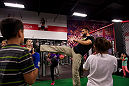 LAS VEGAS, NEVADA - JANUARY 28: UFC welterweight Carlos Condit wows local children with a front kick while visiting the UFC Gym in Green Valley. (Photo by Brandon Magnus/Zuffa LLC/Zuffa LLC)