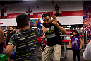 LAS VEGAS, NEVADA - JANUARY 28: Carlos Condit helps a child work on his striking while visiting the UFC Gym in Green Valley. (Photo by Brandon Magnus/Zuffa LLC/Zuffa LLC)