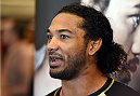 BROOMFIELD, CO - FEBRUARY 12:  Former UFC lightweight champion Benson Henderson interacts with media after an open training session for fans and media at the UFC Gym on February 12, 2015 in Broomfield, Colorado. (Photo by Josh Hedges/Zuffa LLC/Zuffa LLC via Getty Images)