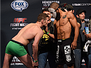 BROOMFIELD, CO - FEBRUARY 13: (L-R) Opponents Chas Skelly and Jim Alers face off during the UFC weigh-in at the 1stBank Center on February 13, 2015 in Broomfield, Colorado. (Photo by Josh Hedges/Zuffa LLC/Zuffa LLC via Getty Images)