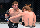 BROOMFIELD, CO - FEBRUARY 14:  (L-R) Zach Makovsky punches Timothy Elliott in their flyweight fight during the UFC Fight Night event inside 1stBank Center on February 14, 2015 in Broomfield, Colorado. (Photo by Josh Hedges/Zuffa LLC/Zuffa LLC via Getty Images)