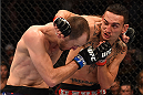 BROOMFIELD, CO - FEBRUARY 14:  (R-L) Max Holloway punches Cole Miller in their featherweight fight during the UFC Fight Night event inside 1stBank Center on February 14, 2015 in Broomfield, Colorado. (Photo by Josh Hedges/Zuffa LLC/Zuffa LLC via Getty Images)
