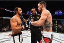 BROOMFIELD, CO - FEBRUARY 14:  (L-R) Benson Henderson and Brandon Thatch touch gloves before their welterweight fight during the UFC Fight Night event inside 1stBank Center on February 14, 2015 in Broomfield, Colorado. (Photo by Josh Hedges/Zuffa LLC/Zuffa LLC via Getty Images)