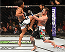 BROOMFIELD, CO - FEBRUARY 14:  (L-R) Benson Henderson attempts a flying knee against Brandon Thatch in their welterweight fight during the UFC Fight Night event inside 1stBank Center on February 14, 2015 in Broomfield, Colorado. (Photo by Josh Hedges/Zuffa LLC/Zuffa LLC via Getty Images)