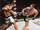 BROOMFIELD, CO - FEBRUARY 14:  (R-L) Brandon Thatch lands a kick to the body of Benson Henderson in their welterweight fight during the UFC Fight Night event inside 1stBank Center on February 14, 2015 in Broomfield, Colorado. (Photo by Josh Hedges/Zuffa LLC/Zuffa LLC via Getty Images)