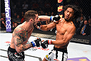 BROOMFIELD, CO - FEBRUARY 14:  (L-R) Brandon Thatch lands a punch to the face of Benson Henderson in their welterweight fight during the UFC Fight Night event inside 1stBank Center on February 14, 2015 in Broomfield, Colorado. (Photo by Josh Hedges/Zuffa LLC/Zuffa LLC via Getty Images)