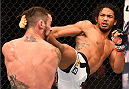 BROOMFIELD, CO - FEBRUARY 14:  (R-L) Benson Henderson lands a kick to the head of Brandon Thatch in their welterweight fight during the UFC Fight Night event inside 1stBank Center on February 14, 2015 in Broomfield, Colorado. (Photo by Josh Hedges/Zuffa LLC/Zuffa LLC via Getty Images)