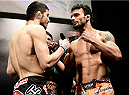 PORTO ALEGRE, BRAZIL - FEBRUARY 21: Rustman Khabilov of Russia and Adriano Martins of Brazil face off  during the UFC Fight Night Weigh-ins at Gigantinho Arena on February 21, 2015 in Porto Alegre, Brazil.  (Photo by Buda Mendes/Zuffa LLC/Zuffa LLC via Getty Images)