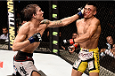 PORTO ALEGRE, BRAZIL - FEBRUARY 22: Cody Gibson of United States punches Douglas D Silva of the Brazil in their lightweight bout during the UFC Fight Night at Gigantinho Gymnasium on February 22, 2015 in Porto Alegre, Brazil. (Photo by Buda Mendes/Zuffa LLC/Zuffa LLC via Getty Images)