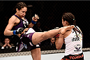 PORTO ALEGRE, BRAZIL - FEBRUARY 22:  Marion Reneau of United States kicks Jessica Andrade of the Brazil in their bantamweight bout during the UFC Fight Night at Gigantinho Gymnasium on February 22, 2015 in Porto Alegre, Brazil.  (Photo by Buda Mendes/Zuffa LLC/Zuffa LLC via Getty Images)