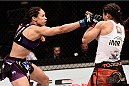 PORTO ALEGRE, BRAZIL - FEBRUARY 22:  Marion Reneau of United States punches Jessica Andrade of the Brazil in their bantamweight bout during the UFC Fight Night at Gigantinho Gymnasium on February 22, 2015 in Porto Alegre, Brazil.  (Photo by Buda Mendes/Zuffa LLC/Zuffa LLC via Getty Images)