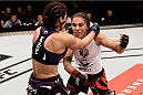 PORTO ALEGRE, BRAZIL - FEBRUARY 22:  Jessica Andrade of Brazil punches Marion Reneau of the United States in their bantamweight bout during the UFC Fight Night at Gigantinho Gymnasium on February 22, 2015 in Porto Alegre, Brazil.  (Photo by Buda Mendes/Zuffa LLC/Zuffa LLC via Getty Images)