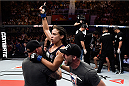 PORTO ALEGRE, BRAZIL - FEBRUARY 22:  Marion Reneau of United States celebrates after defeating  Jessica Andrade of the Brazil in their bantamweight bout during the UFC Fight Night at Gigantinho Gymnasium on February 22, 2015 in Porto Alegre, Brazil.  (Photo by Buda Mendes/Zuffa LLC/Zuffa LLC via Getty Images)