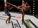 PORTO ALEGRE, BRAZIL - FEBRUARY 22: Edson Barboza of Brazil kicks Michael Johnson of the United States in their lightweight bout during the UFC Fight Night at Gigantinho Gymnasium on February 22, 2015 in Porto Alegre, Brazil. (Photo by Buda Mendes/Zuffa LLC/Zuffa LLC via Getty Images)