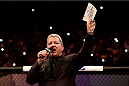"PORTO ALEGRE, BRAZIL - FEBRUARY 22:  Octagon announcer Bruce Buffer introduces the fighters before the heavyweight bout between Antonio ""Bigfoot"" Silva of Brazil and Frank Mir of the United States during the UFC Fight Night at Gigantinho Gymnasium on February 22, 2015 in Porto Alegre, Brazil.  (Photo by Buda Mendes/Zuffa LLC/Zuffa LLC via Getty Images)"