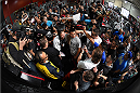 TORRANCE, CA - FEBRUARY 24:  UFC women's bantamweight champion Ronda Rousey signs autographs after an open training session for fans and media at the UFC Gym on February 24, 2015 in Torrance, California. (Photo by Josh Hedges/Zuffa LLC/Zuffa LLC via Getty Images)