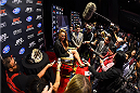 LOS ANGELES, CA - FEBRUARY 25:  UFC women's bantamweight champion Ronda Rousey interacts with media during the UFC 184 Ultimate Media Day at Club Nokia on February 25, 2015 in Los Angeles, California. (Photo by Josh Hedges/Zuffa LLC/Zuffa LLC via Getty Images)