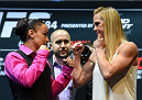 LOS ANGELES, CA - FEBRUARY 25:  (L-R) Opponents Raquel Pennington and Holly Holm face off during the UFC 184 Ultimate Media Day at Club Nokia on February 25, 2015 in Los Angeles, California. (Photo by Josh Hedges/Zuffa LLC/Zuffa LLC via Getty Images)