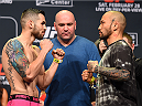 LOS ANGELES, CA - FEBRUARY 27:  (L-R) Opponents Roman Salazar and Norifumi 'Kid' Yamamoto of Japan face off during the UFC 184 weigh-in at the Event Deck and LA Live on February 27, 2015 in Los Angeles, California. (Photo by Josh Hedges/Zuffa LLC/Zuffa LLC via Getty Images)