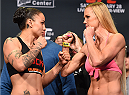 LOS ANGELES, CA - FEBRUARY 27:  (L-R) Opponents Raquel Pennington and Holly Holm face off during the UFC 184 weigh-in at the Event Deck and LA Live on February 27, 2015 in Los Angeles, California. (Photo by Josh Hedges/Zuffa LLC/Zuffa LLC via Getty Images)