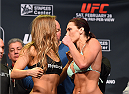 LOS ANGELES, CA - FEBRUARY 27:  (L-R) Opponents Ronda Rousey and Cat Zingano face off during the UFC 184 weigh-in at the Event Deck and LA Live on February 27, 2015 in Los Angeles, California. (Photo by Josh Hedges/Zuffa LLC/Zuffa LLC via Getty Images)