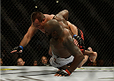 LOS ANGELES, CA - FEBRUARY 28:  (Bottom) Derrick Lewis takes down Ruan Potts in their heavyweight bout during the UFC 184 event at Staples Center on February 28, 2015 in Los Angeles, California.  (Photo by Jeff Gross/Zuffa LLC/Zuffa LLC via Getty Images)