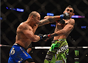 LOS ANGELES, CA - FEBRUARY 28:  (L) Gleison Tibau punches Tony Ferguson in their lightweight bout during the UFC 184 event at Staples Center on February 28, 2015 in Los Angeles, California.  (Photo by Jeff Bottari/Zuffa LLC/Zuffa LLC via Getty Images)