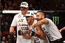 LOS ANGELES, CA - FEBRUARY 28:  (Middle) ony Ferguson celebrates after defeating Gleison Tibau in their lightweight bout during the UFC 184 event at Staples Center on February 28, 2015 in Los Angeles, California.  (Photo by Josh Hedges/Zuffa LLC/Zuffa LLC via Getty Images)