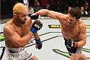 LOS ANGELES, CA - FEBRUARY 28:  (R-L) Jake Ellenberger punches Josh Koscheck in their welterweight bout during the UFC 184 event at Staples Center on February 28, 2015 in Los Angeles, California.  (Photo by Josh Hedges/Zuffa LLC/Zuffa LLC via Getty Images)