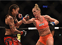 LOS ANGELES, CA - FEBRUARY 28:  (R) Holly Holm punches Raquel Pennington in their women's bantamweight bout during the UFC 184 event at Staples Center on February 28, 2015 in Los Angeles, California.  (Photo by Jeff Bottari/Zuffa LLC/Zuffa LLC via Getty Images)