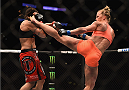 LOS ANGELES, CA - FEBRUARY 28:  (R) Holly Holm kicks Raquel Pennington in their women's bantamweight bout during the UFC 184 event at Staples Center on February 28, 2015 in Los Angeles, California.  (Photo by Jeff Bottari/Zuffa LLC/Zuffa LLC via Getty Images)
