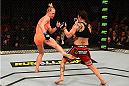 LOS ANGELES, CA - FEBRUARY 28:  (L) Holly Holm kicks Raquel Pennington in their women's bantamweight bout during the UFC 184 event at Staples Center on February 28, 2015 in Los Angeles, California.  (Photo by Josh Hedges/Zuffa LLC/Zuffa LLC via Getty Images)