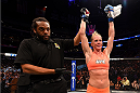 LOS ANGELES, CA - FEBRUARY 28:  Holly Holm celebrates her win over Raquel Pennington after their women's bantamweight bout during the UFC 184 event at Staples Center on February 28, 2015 in Los Angeles, California.  (Photo by Josh Hedges/Zuffa LLC/Zuffa LLC via Getty Images)