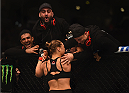 LOS ANGELES, CA - FEBRUARY 28:  Ronda Rousey celebrates her victory over Cat Zingano in their UFC women's bantamweight championship bout during the UFC 184 event at Staples Center on February 28, 2015 in Los Angeles, California.  (Photo by Jeff Bottari/Zuffa LLC/Zuffa LLC via Getty Images)