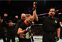 LOS ANGELES, CA - FEBRUARY 28:  Ronda Rousey celebrates her victory over Cat Zingano in their UFC women's bantamweight championship bout during the UFC 184 event at Staples Center on February 28, 2015 in Los Angeles, California.  (Photo by Josh Hedges/Zuffa LLC/Zuffa LLC via Getty Images)