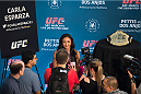 DALLAS, TX - MARCH 12:  UFC women's strawweight champion Carla Esparza speaks with the media during the UFC 185 Ultimate Media Day at the American Airlines Center on March 12, 2015 in Dallas, Texas. (Photo by Cooper Neill/Zuffa LLC/Zuffa LLC via Getty Images)