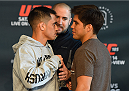 DALLAS, TX - MARCH 12:  (L-R) Opponents Chris Cariaso and Henry Cejudo face off during the UFC 185 Ultimate Media Day at the American Airlines Center on March 12, 2015 in Dallas, Texas. (Photo by Josh Hedges/Zuffa LLC/Zuffa LLC via Getty Images)