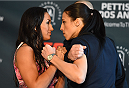 DALLAS, TX - MARCH 12:  (L-R) UFC women's strawweight champion Carla Esparza and opponent Joanna Jedrzejczyk of Poland face off during the UFC 185 Ultimate Media Day at the American Airlines Center on March 12, 2015 in Dallas, Texas. (Photo by Josh Hedges/Zuffa LLC/Zuffa LLC via Getty Images)