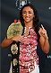 DALLAS, TX - MARCH 12:  UFC women's strawweight champion Carla Esparza poses for photos during the UFC 185 Ultimate Media Day at the American Airlines Center on March 12, 2015 in Dallas, Texas. (Photo by Josh Hedges/Zuffa LLC/Zuffa LLC via Getty Images)