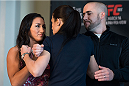 DALLAS, TX - MARCH 12:  UFC women's strawweight champion Carla Esparza faces off with Joanna Jedrzejczyk during the UFC 185 Ultimate Media Day at the American Airlines Center on March 12, 2015 in Dallas, Texas. (Photo by Cooper Neill/Zuffa LLC/Zuffa LLC via Getty Images)