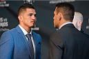 DALLAS, TX - MARCH 12:  UFC Lightweight Champion Anthony Pettis faces off against Rafael Dos Anjos during the UFC 185 Ultimate Media Day at the American Airlines Center on March 12, 2015 in Dallas, Texas. (Photo by Cooper Neill/Zuffa LLC/Zuffa LLC via Getty Images)
