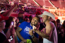 "DALLAS, TX - MARCH 13: Donald ""Cowboy"" Cerrone takes a photo with a fan during the UFC 185 weigh-ins at the Kay Bailey Hutchison Convention Center on March 13, 2015 in Dallas, Texas. (Photo by Cooper Neill/Zuffa LLC/Zuffa LLC via Getty Images)"