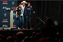 "DALLAS, TX - MARCH 13: Megan Olivi and Donald ""Cowboy"" Cerrone pose for a photo with a fan before the UFC 185 weigh-ins at the Kay Bailey Hutchison Convention Center on March 13, 2015 in Dallas, Texas. (Photo by Cooper Neill/Zuffa LLC/Zuffa LLC via Getty Images)"