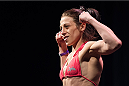 DALLAS, TX - MARCH 13: Joanna Jedrzejczyk stands on the scale during the UFC 185 weigh-ins at the Kay Bailey Hutchison Convention Center on March 13, 2015 in Dallas, Texas. (Photo by Cooper Neill/Zuffa LLC/Zuffa LLC via Getty Images)