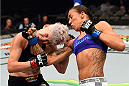DALLAS, TX - MARCH 14:  (R-L) Germaine de Randamie lands a punch to the chin of Larissa Pacheco in their women's bantamweight bout during the UFC 185 event at the American Airlines Center on March 14, 2015 in Dallas, Texas. (Photo by Josh Hedges/Zuffa LLC/Zuffa LLC via Getty Images)