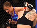 DALLAS, TX - MARCH 14:  (L-R) Germaine de Randamie lands a punch to the chin of Larissa Pacheco in their women's bantamweight bout during the UFC 185 event at the American Airlines Center on March 14, 2015 in Dallas, Texas. (Photo by Josh Hedges/Zuffa LLC/Zuffa LLC via Getty Images)