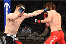 DALLAS, TX - MARCH 14:  (L-R) Joseph Duffy of Ireland lands a punch to the head of Jake Lindsey in their lightweight bout during the UFC 185 event at the American Airlines Center on March 14, 2015 in Dallas, Texas. (Photo by Josh Hedges/Zuffa LLC/Zuffa LLC via Getty Images)