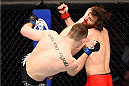 DALLAS, TX - MARCH 14:  (L-R) Joseph Duffy lands a kick to the head of Jake Lindsey in their lightweight bout during the UFC 185 event at the American Airlines Center on March 14, 2015 in Dallas, Texas. (Photo by Josh Hedges/Zuffa LLC/Zuffa LLC via Getty Images)